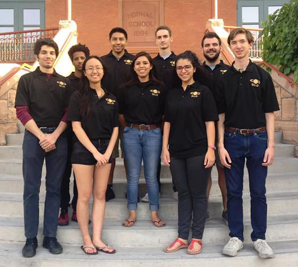 "Photo of a group of students standing on the steps of Old Main with a caption of ""The Next Level Devils on the steps of Old Main. Back row (L-R) Garrett Nez, Evren Uner. Middle row (L-R) Gashaw Bizana, Brittany Nez, Christian Sclafani. Front row (L-R) Alessandro Laspina, Justine Tang, Maria Samir and Patrick Hull. Not pictured Alek Cook, Robert Mann and Wakhile Shongwe. Photo courtesy of Next Level Devils"""
