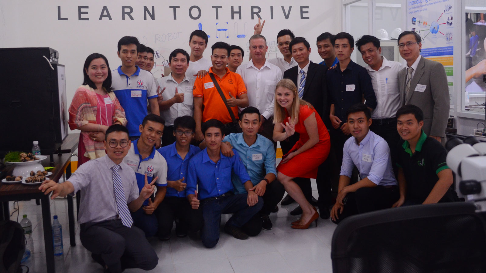 "Photo of large group of people posing with a caption of ""Arizona State University helped launch the Maker Innovation Space in Ho Chi Minh City, Vietnam, as part of the Building University-Industry Learning and Develop through Innovation and Technology program known as BUILD-IT, which brings academia, industry and government together to invest in a dynamic ecosystem for STEM innovation in Vietnam. Photo courtesy of BUILD-IT"""