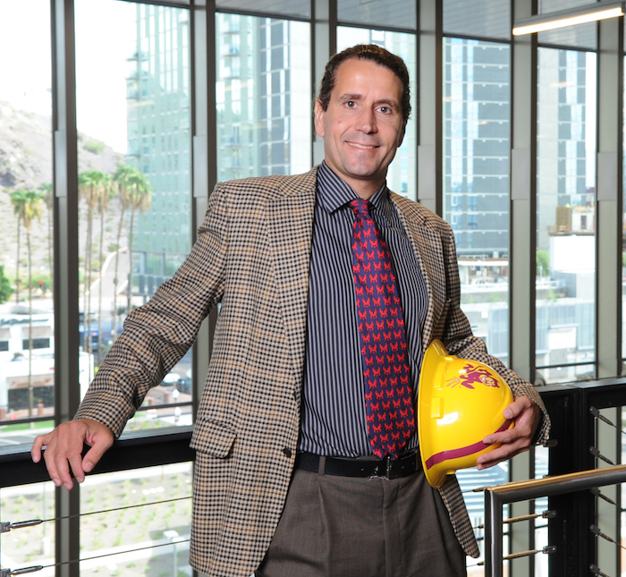 Portrait of David Grau holding an ASU hardhat