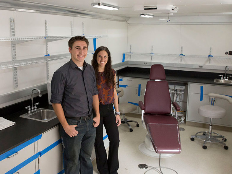 Nick Kemme and Sara Mantlik show off the completed mobile dental clinic, which will expand the mission impact of IMAHelps, a nonprofit group that provides dental and medical care to underserved populations in Central and South America.