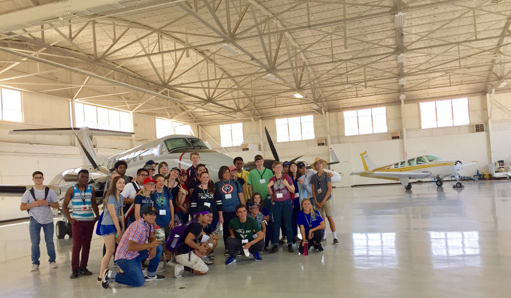 National Summer Transportation Institute visiting the hangars and tarmac at Gateway Airport in Mesa