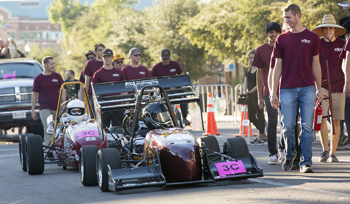 Photo of a race car. Caption: Sun Devil Motorsports, the Formula chapter of the Society of Automotive Engineers at ASU, brought the noise to the Homecoming Parade, showing off the latest incarnation of their competition car. The student organization, which designs, builds and races a car from scratch, also set up at the Block Party, inviting guests of all ages to take a look at their work. Photographer: Jessica Hochreiter/ASU