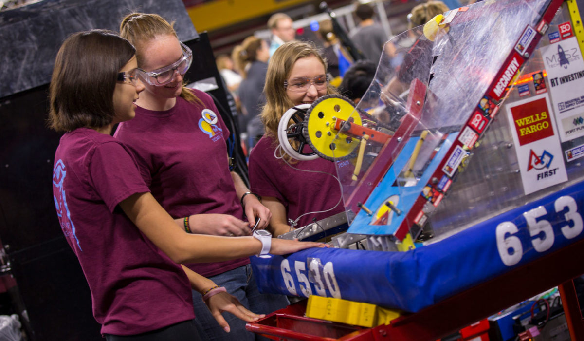 Students work on their robot at the FIRST Robotics Competition Arizona State Championship at Wells Fargo Arena.