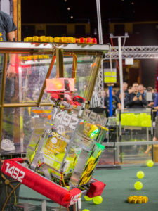 A robot hangs on a tower at the FIRST Robotics Competition Arizona State Championship at Wells Fargo Arena