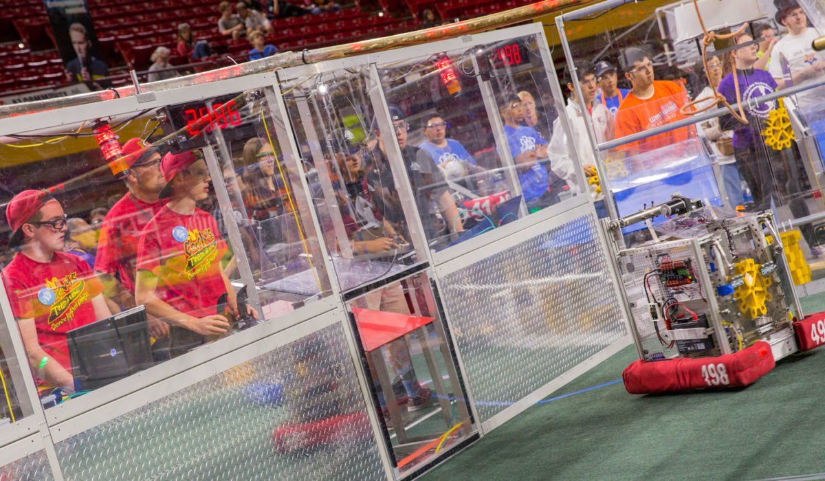 Student teams drive their robots in the arena at the FIRST Robotics Competition Arizona State Championship at Wells Fargo Arena.