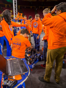Team Crush members work on their robot between rounds of the FIRST Robotics Competition Arizona State Championship at Wells Fargo Arena.