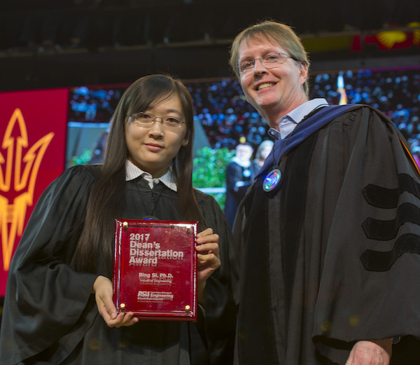 Photo of Bing Si holding a plaque next to Kyle Squires. Caption: Bing Si received the 2017 Dean's Dissertation Award from Dean Kyle Squires at the Fulton Schools' Fall 2017 Convocation. Photographer: Jessica Hochreiter/ASU