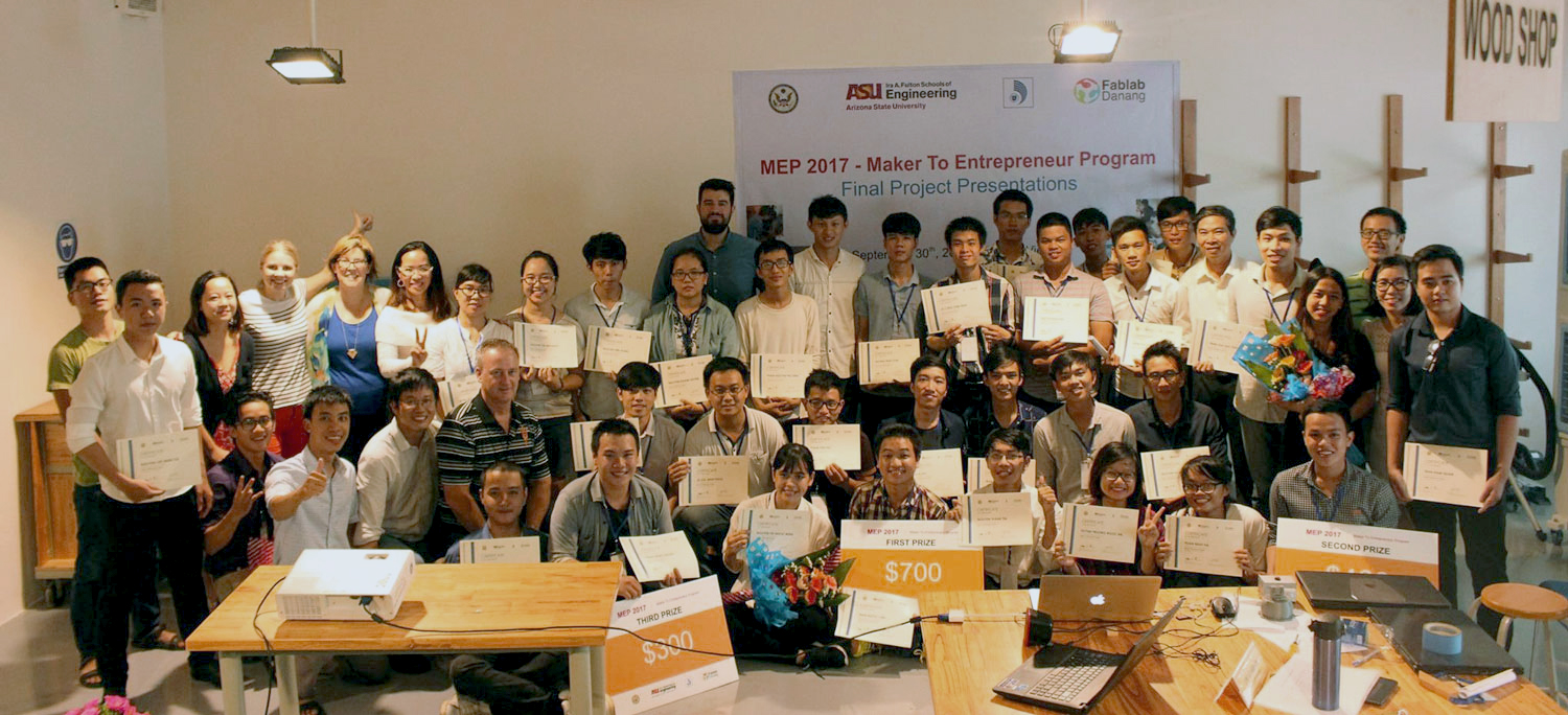 Large group photo of students. Caption: Seven teams competed in the final round of the Maker to Entrepreneur Program's competition in September 2017. The top three teams took home $1,400 in prizes. Photo courtesy of Thao Nguyen