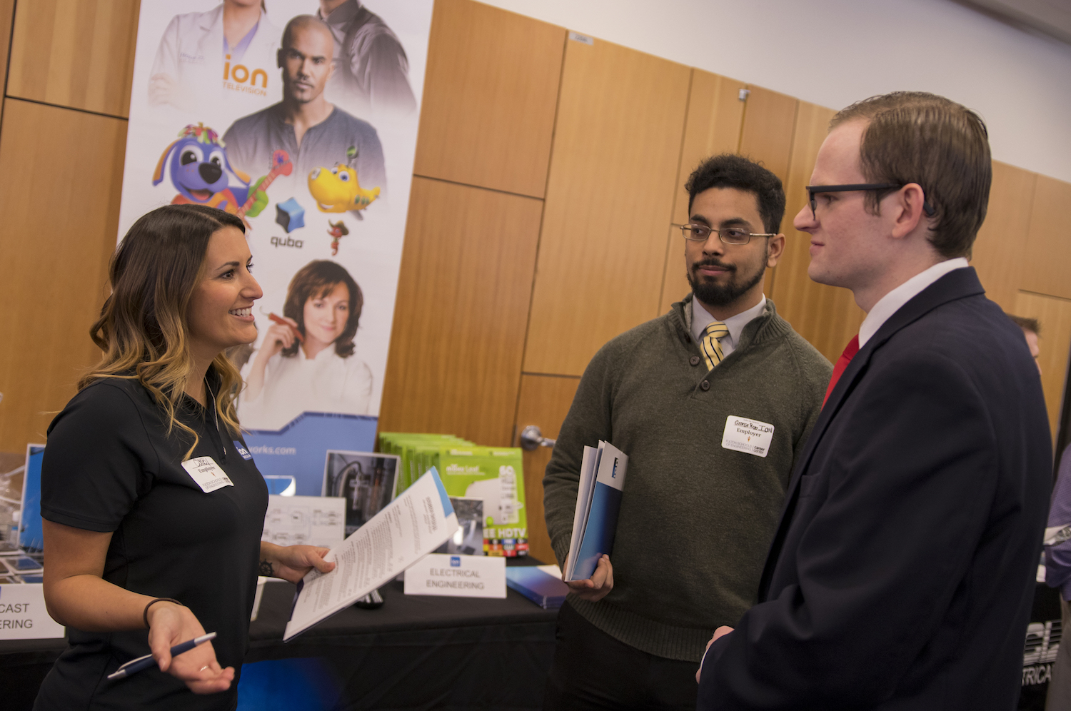 Photo of a student talking with a pair of recruiters. Caption: Representatives from more than 400 companies and organizations met about 3,500 Fulton Schools students at the recent Career Fairs Days at Arizona State University Tempe and Polytechnic campuses. Photographer: Marco Alexis-Chaira/ASU