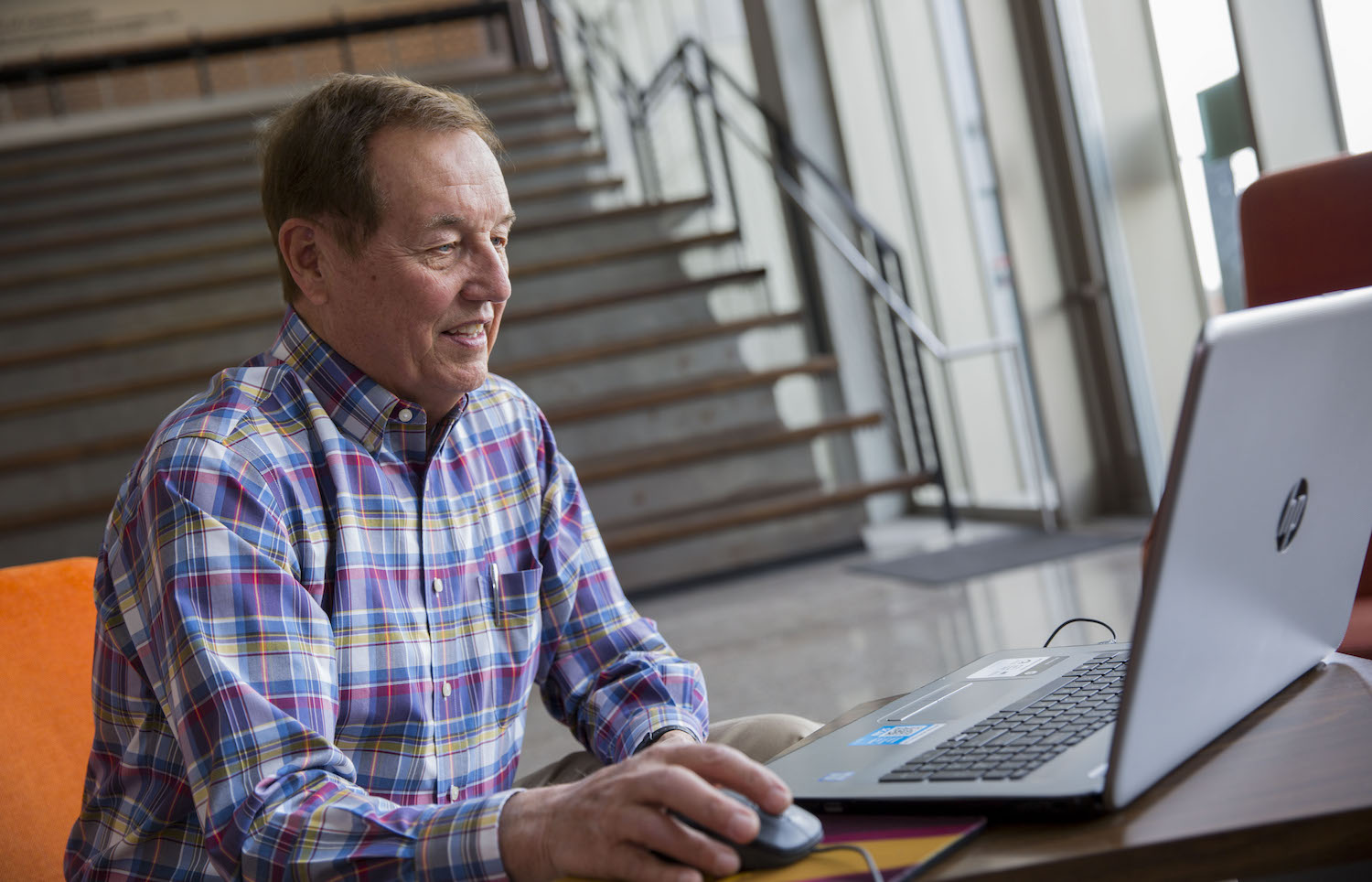 Photo of man sitting in front of a laptop. Caption: Arizona State University structural engineering alumnus John P. Nerison, PE, volunteers his free time by tutoring students from across the country online. He wants to give back to the engineering profession and community by helping more students thrive in their engineering education. Photographer: Jessica Hochreiter/ASU