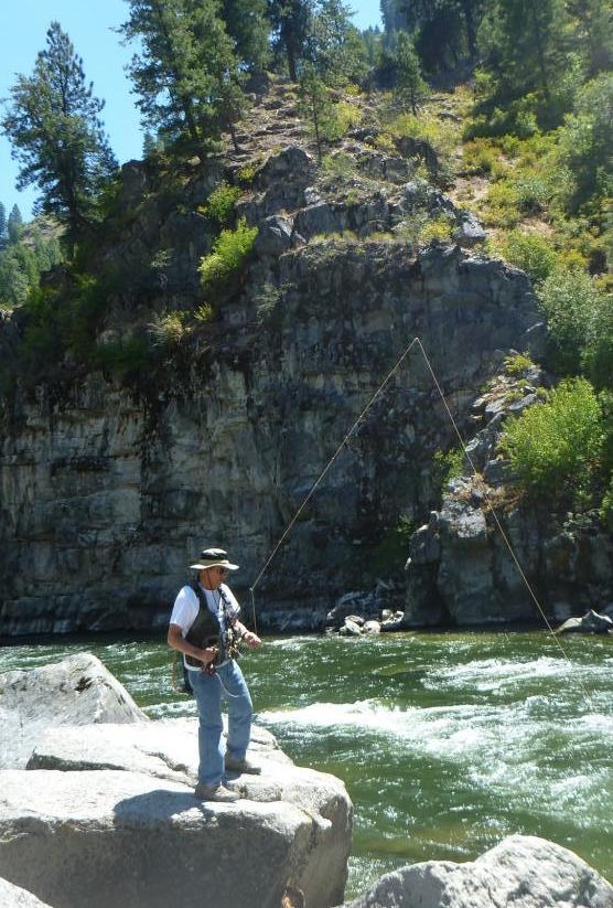 Photo of a man fishing. Caption: Nerison also spends his retirement traveling with his wife and fishing in Idaho's beautiful rivers in the summer. Photo courtesy of John P. Nerison, PE