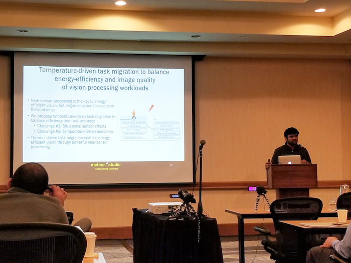 Photo of a man making a presentation in a classroom. Caption: Computer engineering (electrical engineering) graduate student Venkatesh Kodukula presents his research on improvements to mobile image capture and processing systems at ACM HotMobile '18. Kodukula was one of the two ASU students who had papers accepted by the conference. Photo courtesy of Robert LiKamWa.
