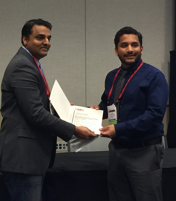 Photo of two men holding a certificate. Caption: Lead writer Chaitanya Kale accepts the Light Metals Division Magnesium Technology Award at the 147th Annual TMS Meeting for Best Student Paper. Photo courtesy of Chaitanya Kale.