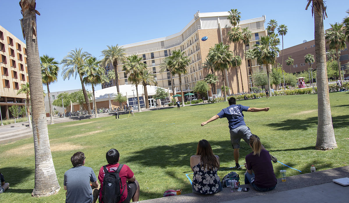 Photo of a concrete frisbee in the air. Caption: Note the blue disc visible above the palm trees against the backdrop of an ASU campus residence hall. The disc competition may seem simplistic, but the flight performance of any particular concrete disc hinges on its makers' understanding of some relatively complex science and engineering principles. Photographer: Marco-Alexis Chaira/ASU