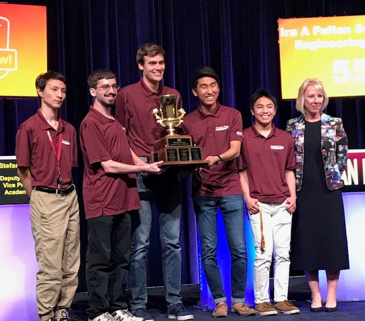 Photo of five students holding a trophy with Stefani Lindquist. Caption: The Fulton Schools Maroon team with ASU Deputy Provost and Vice President for Academic Affairs Stefani Lindquist. Photographer: Cortney Loui/ASU