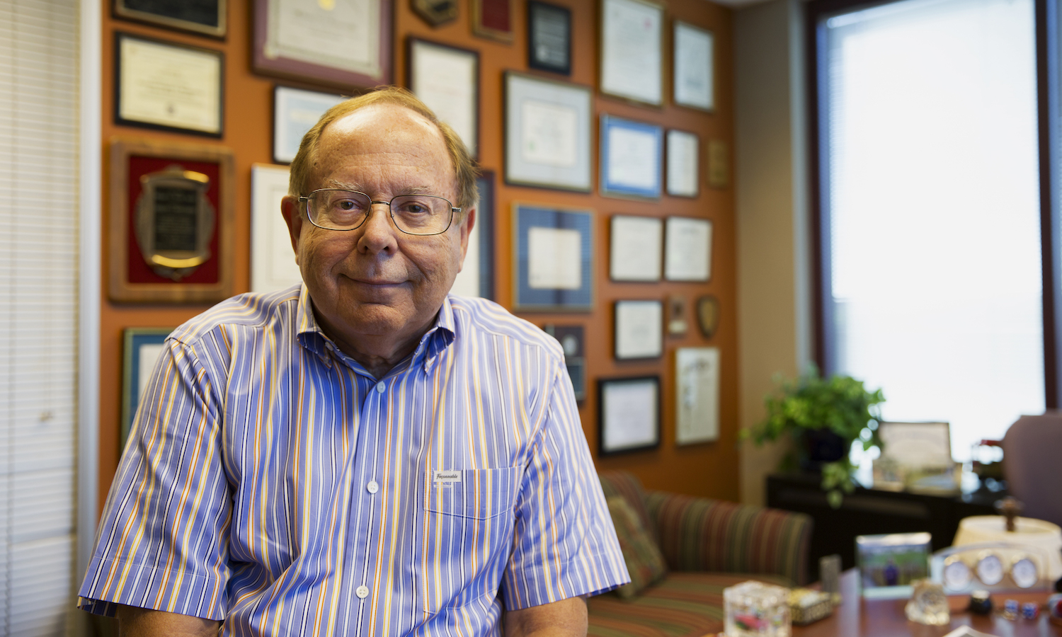 Photo of Doug Montgomery in his office. Caption: Regents' Professor Douglas Montgomery has established a charitable reminder trust to help fund graduate education and a new professorship in industrial engineering in the Fulton Schools. Photographer: Jessica Hochreiter/ASU