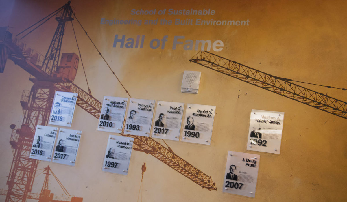 Photo of plaques on a wall that says Hall of Fame