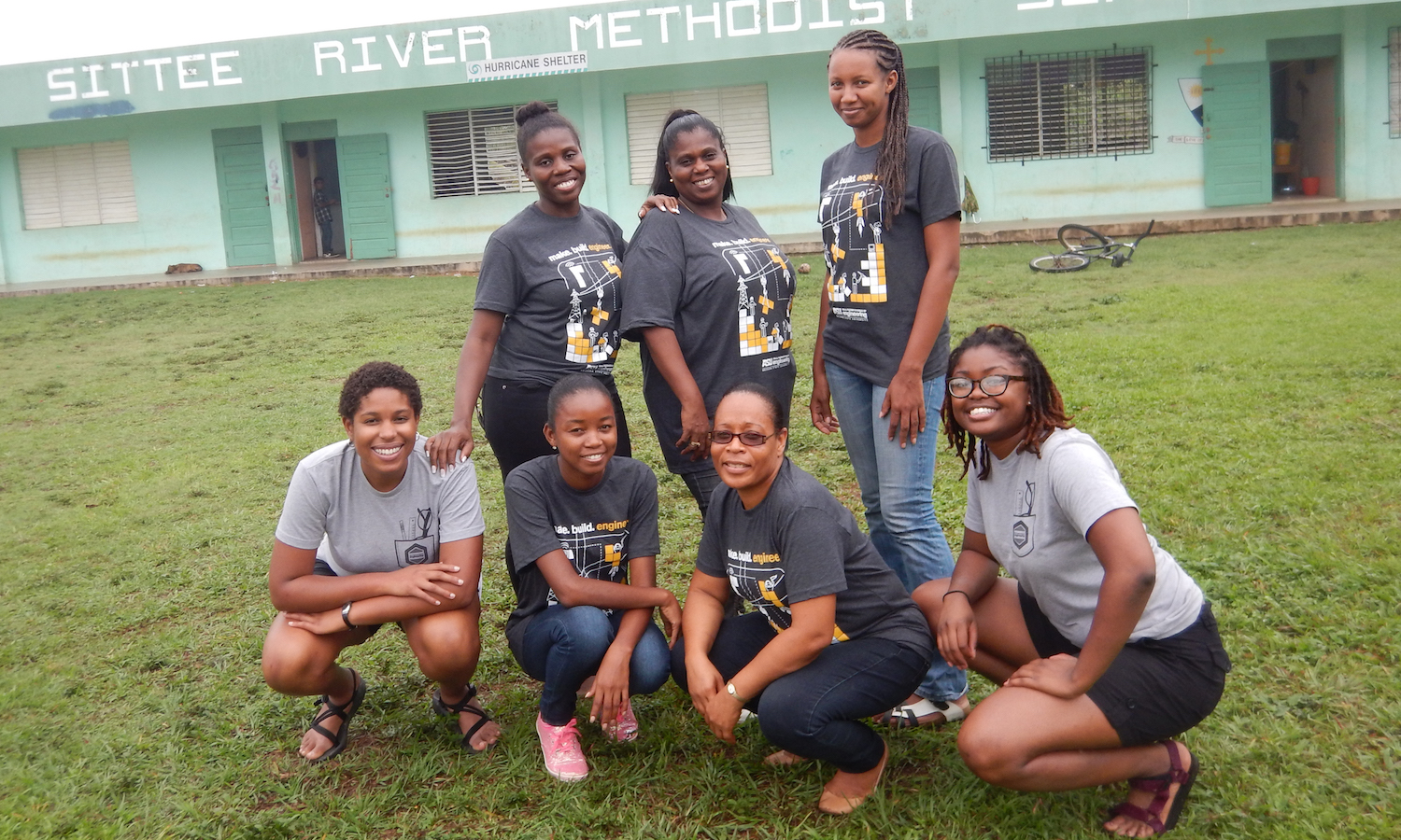 Photo of seven women posing outdoors. Globally Caption: Fulton Schools sustainable engineering doctoral student Evvan Morton (far left) and Shakira Hobbs, an engineering research associate at the University of Virginia (far right), are shown with school teachers in the Belize village of Sittee River. Morton and Hobbs are leaders of a project aimed at helping the remote rural community to adopt renewable energy technology and establish an environmentally safe waste management system. Photo courtesy of Evvan Morton and Shakira Hobbs.
