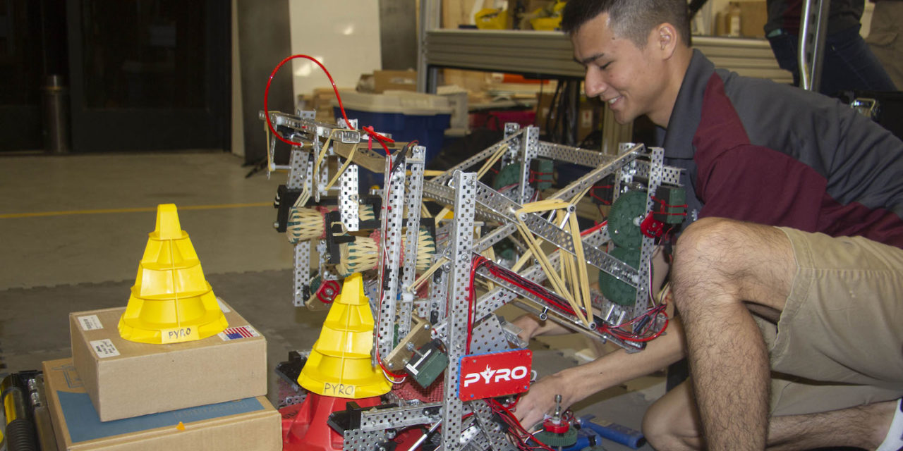 Photo of student working on a robot. Caption: Ryan Bodhipaksha, a robotics engineering major at Arizona State University and co-lead of PYRO Robotics, practices with the team's robot to prepare for the VEX Robotics World Championship 2018. Photo courtesy of Samantha Blokker