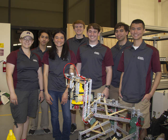 Photo of seven students standing behind a robot. Caption: Arizona State University's Rossum Rumblers PYRO Team: (from left to right) Olivia Pinkowski, Jonathan Nguyen, Rachel Risher, Andrew Fechter, Nathan Rossi, Ben Levine and Ryan Bodhipaksh. Not pictured: Coach Aaron Dolgin. Photo courtesy of Samantha Blokker