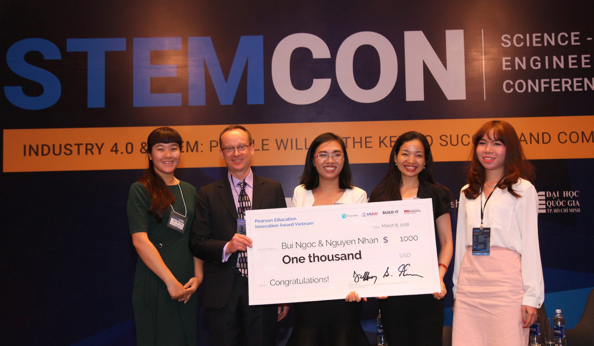 Brian Epp, director of student success with Pearson Education (second from left), awards the Pearson Education Innovation Award Vietnam to Bui Ngoc & Nguyen Nhan. The award is designed to promote innovative practices in all aspects of teaching and learning in STEM fields.
