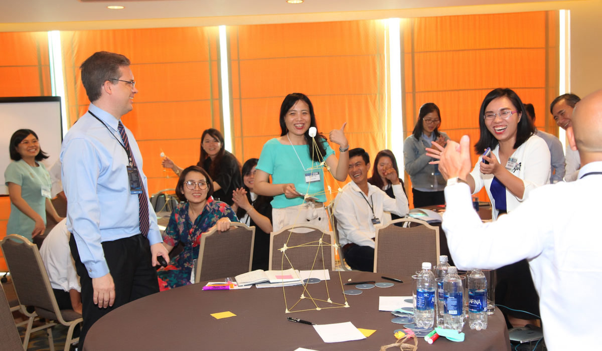 "Rivadavia Alvarenga Neto (far left), global business development officer at EdPlus, at Arizona State University leads an activity in his interactive workshop:, ""Business Model Generation."""