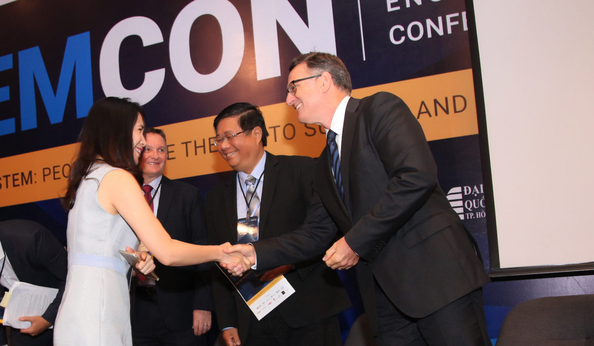 Tran Thi Yen Dinh (far left), education sector director with Microsoft Vietnam, shakes hands with Oracle Academy Asia Regional Director Damian Haas as they prepare to discuss public private partnerships in the era of Industry 4.0.