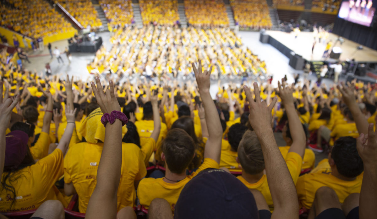 Students make pitchfork sign with hands at Fall Welcome 2018