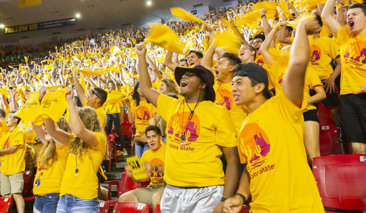 group of people waving towels
