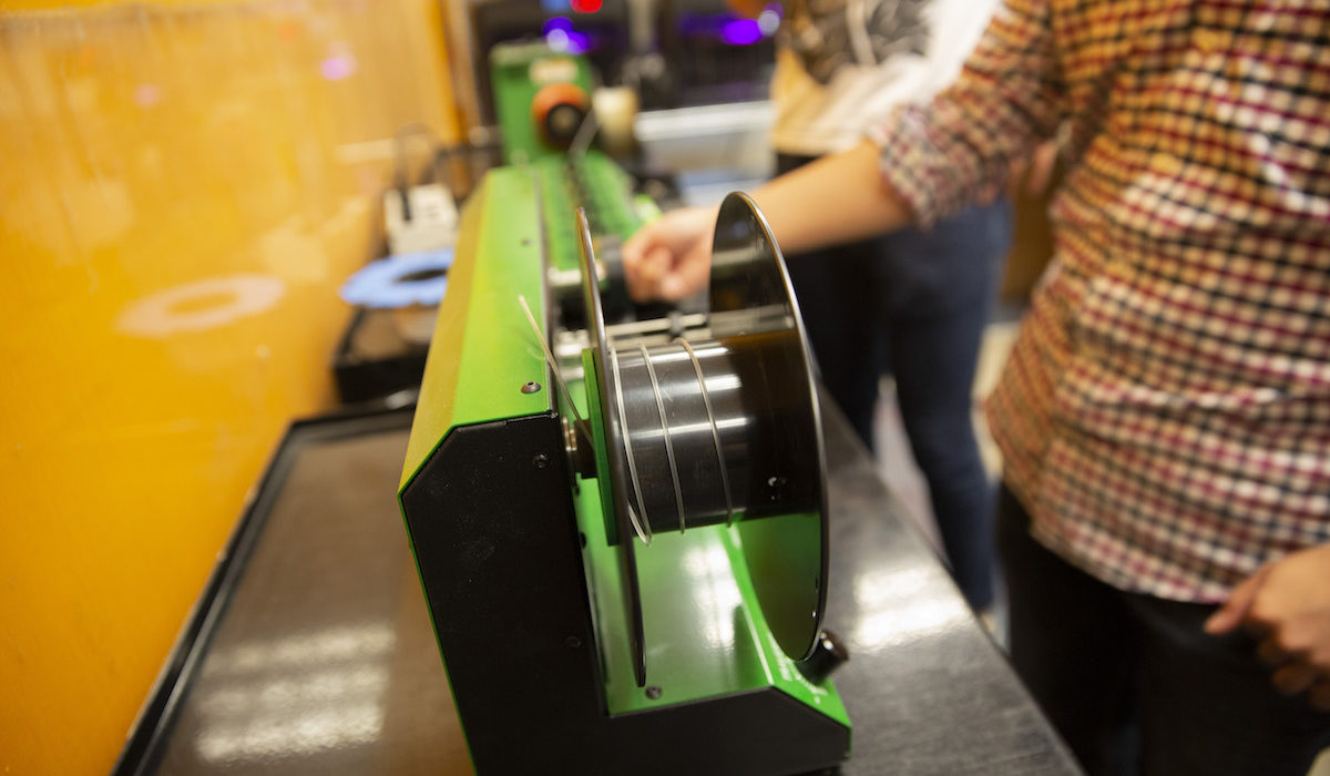 The finished recycled plastic is wound onto a spool.