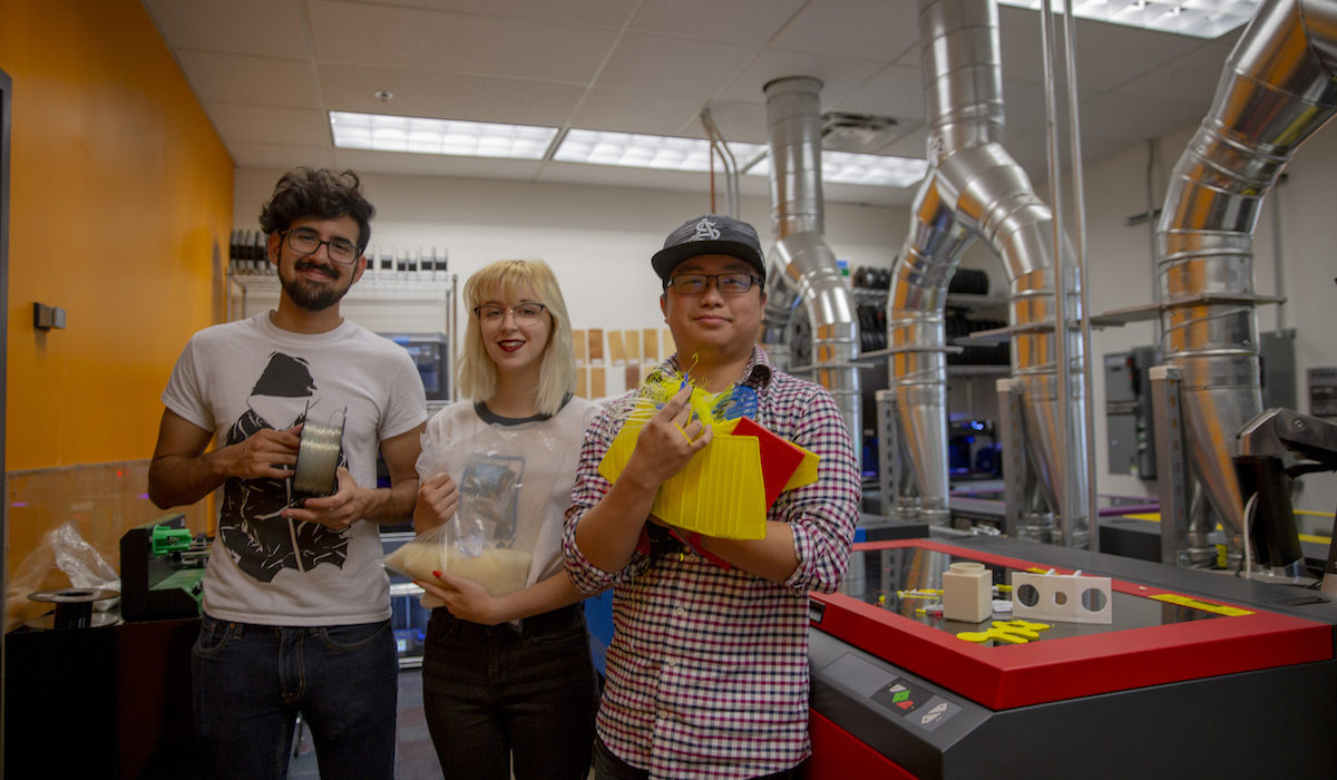Mechanical engineering sophomore Kenny Truong holds waste PLA pieces from the lab. Computer science freshman Morgan Kennedy holds a bag of pellets made of new plastic from manufacturer Filabot that the lab team used to test the extruder tool. Mechanical engineering senior Ruy Garciaacosta holds a spool of recycled filament.
