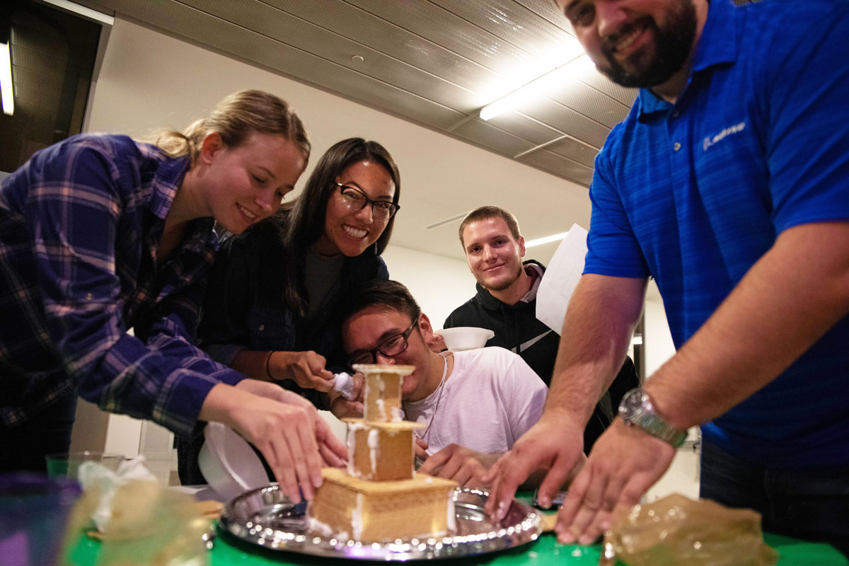 students building a gingerbread house