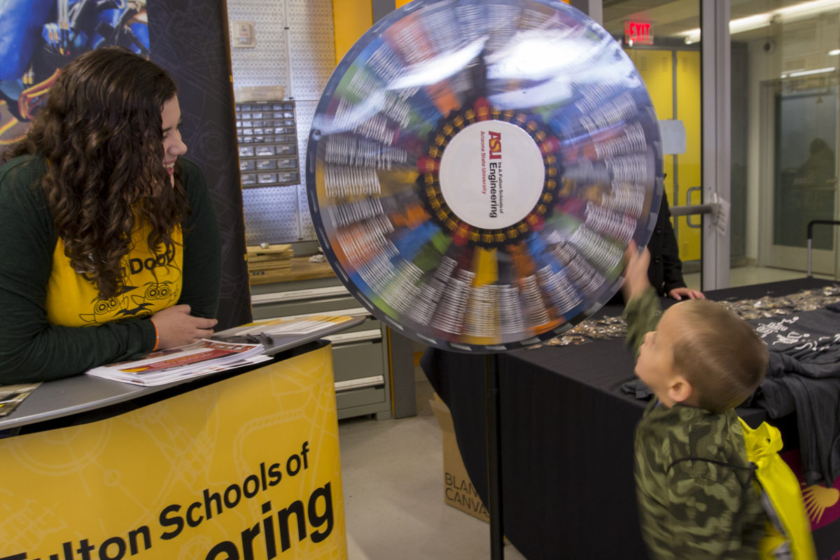 boy spinning a wheel