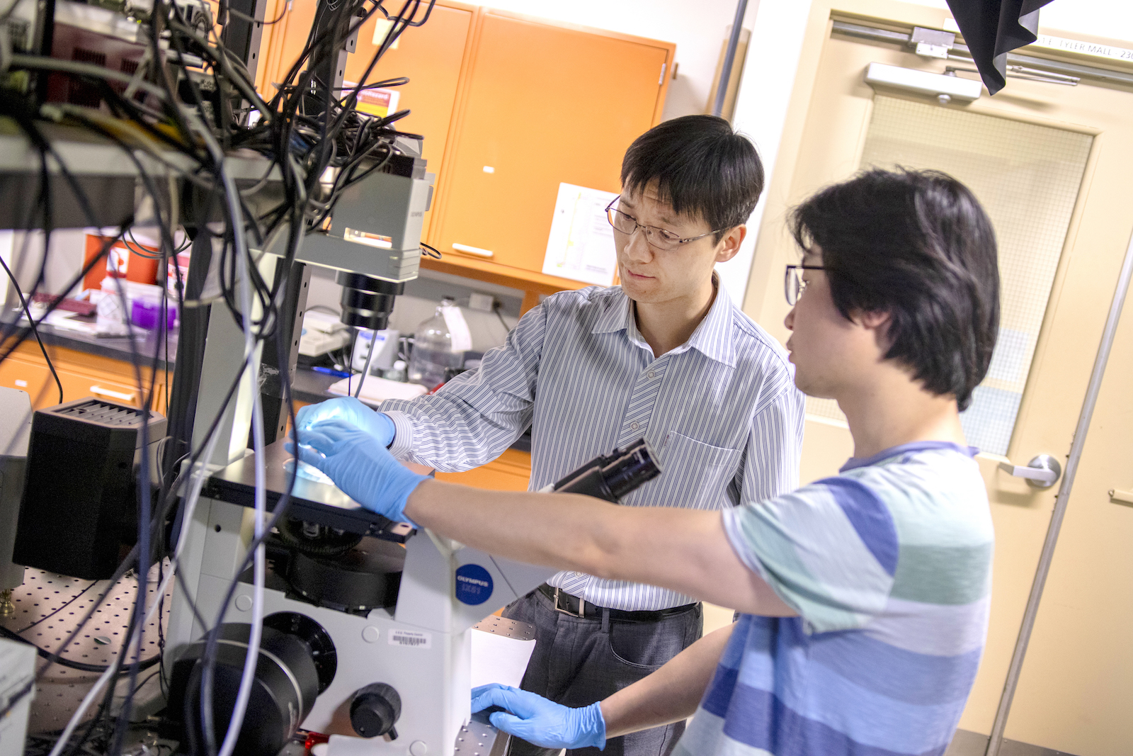 Chao Wang and student working in a lab