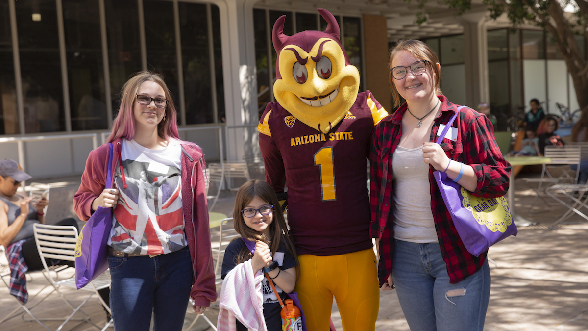 girl scouts standing with Sparky the Sun Devil
