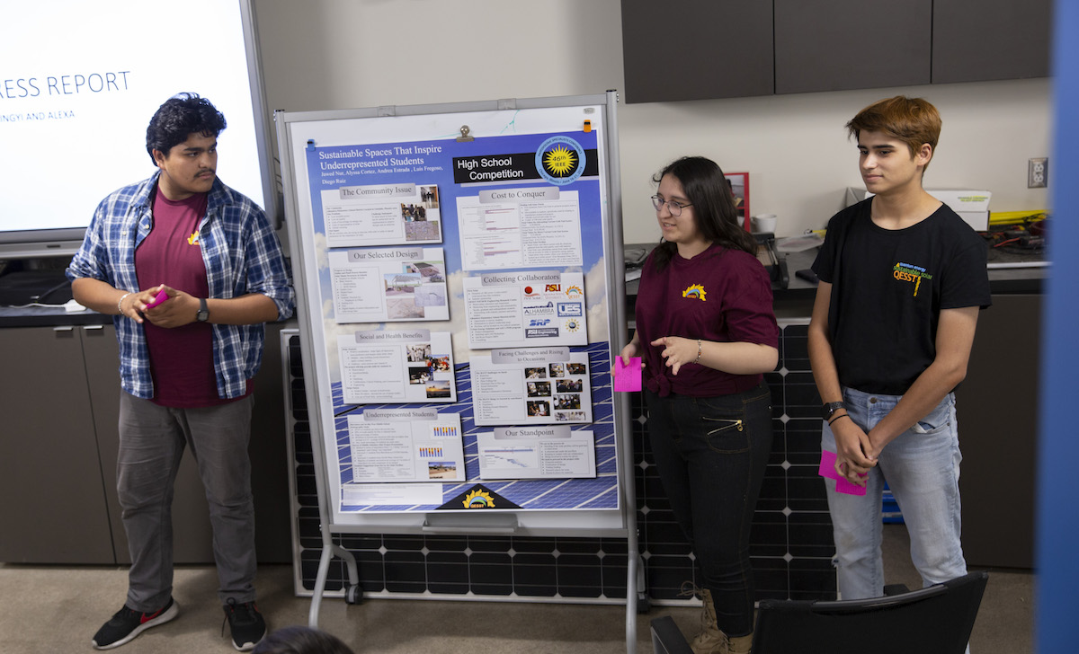 Three students giving a presentation