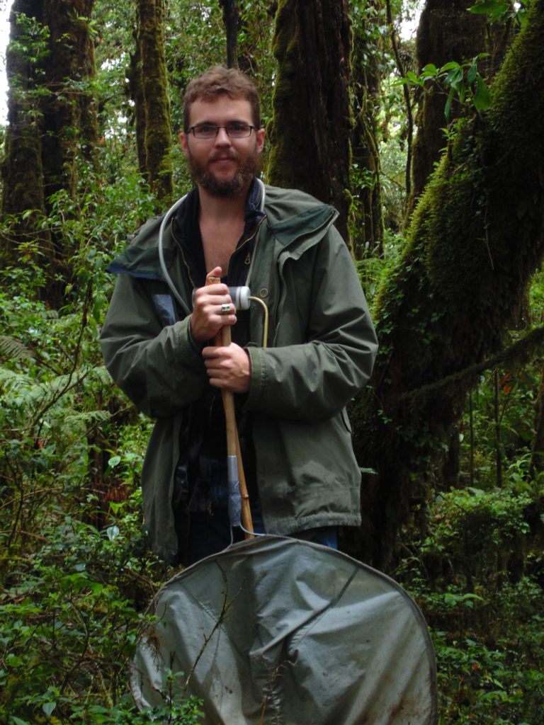 Andrew Jansen poses with a bug net in Guatemala