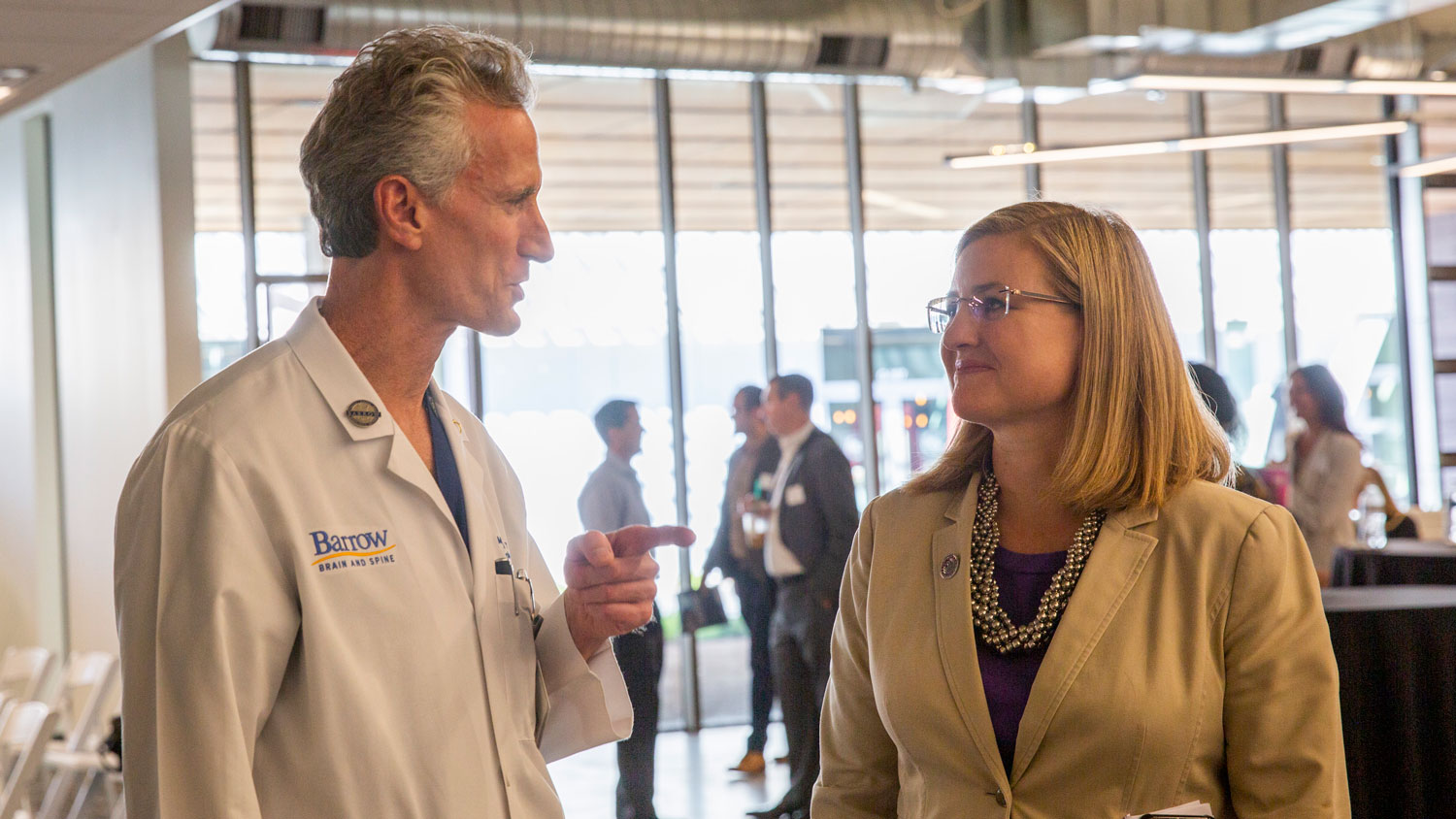 Barrow Neurological Institute President and CEO Michael Lawton (left) and Phoenix Mayor Kate Gallego talk.