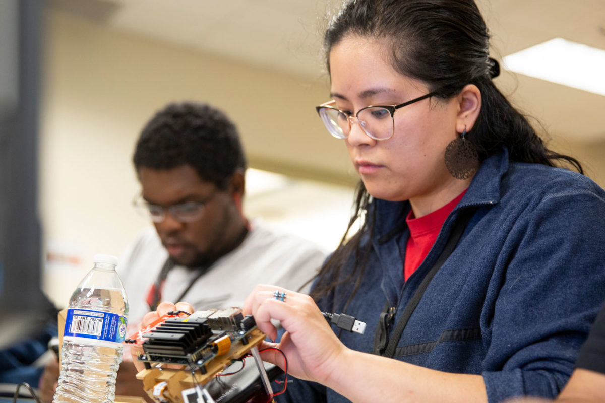 students working on robot