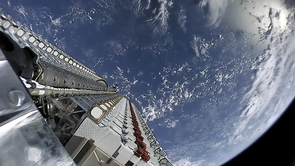 view from space of SpaceX deploying satellites