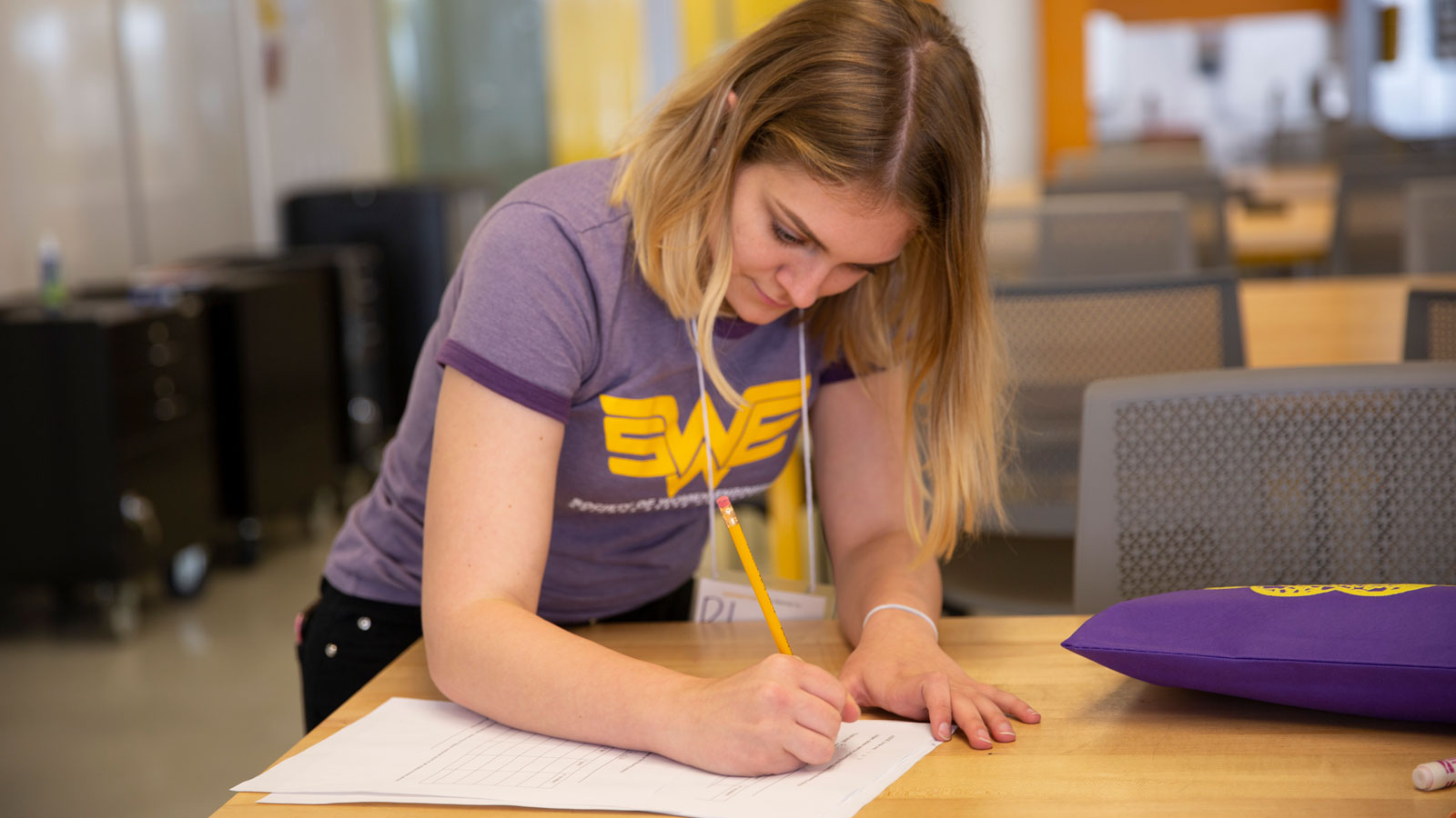 A student member of the ASU Society of Women Engineers chapter works on an outreach event project for young students.