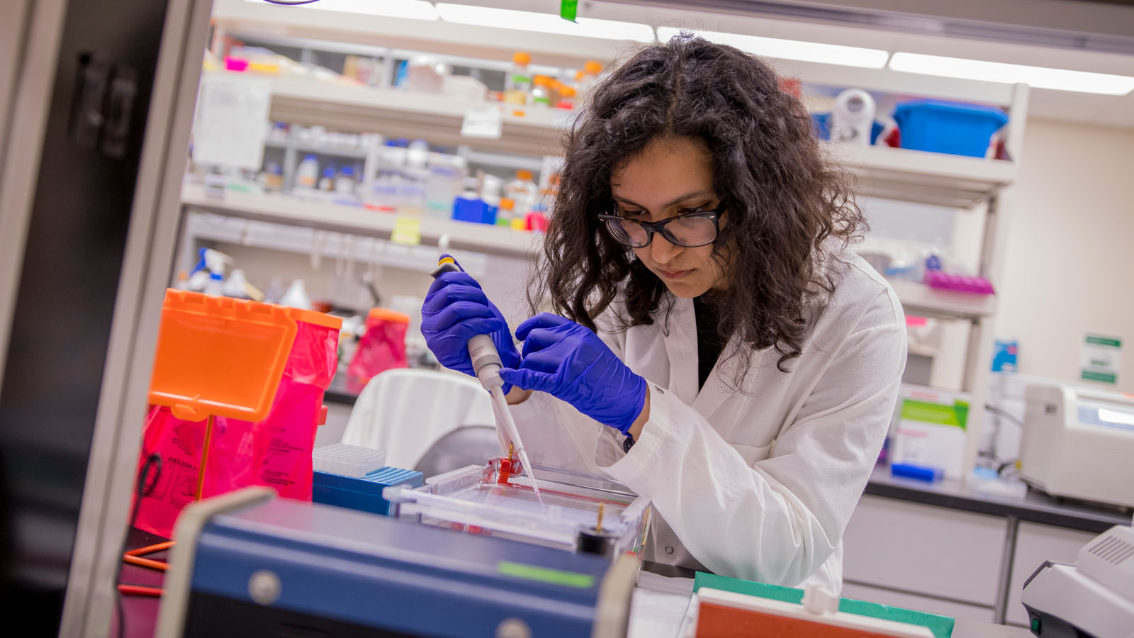 Grand Challenges Scholar Ava Karanjia works on chemical engineering and microbiology research in the lab.