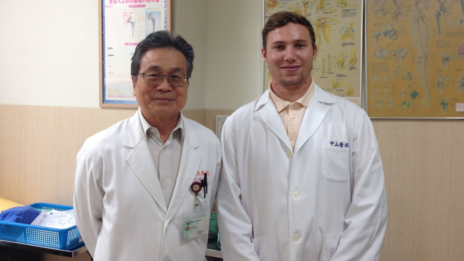 Grand Challenges Scholar Dean Spyres (right) poses with an orthopedic surgeon at Taipei Chang Gung Memorial Hospital.