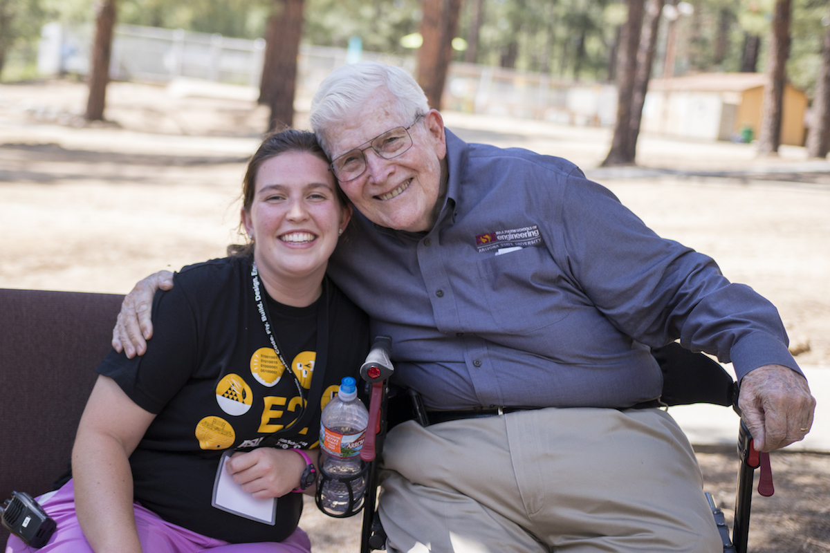 Emily Nugent with Ira A. Fulton at an E2 camp in 2018.
