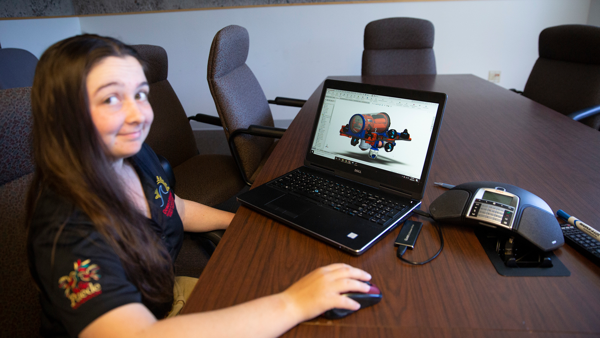 female student sitting in front of a laptop with a submarine on the screen