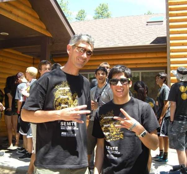 Former Fulton Schools Dean Paul Johnson and Nick Corrales at an E2 camp in 2012.