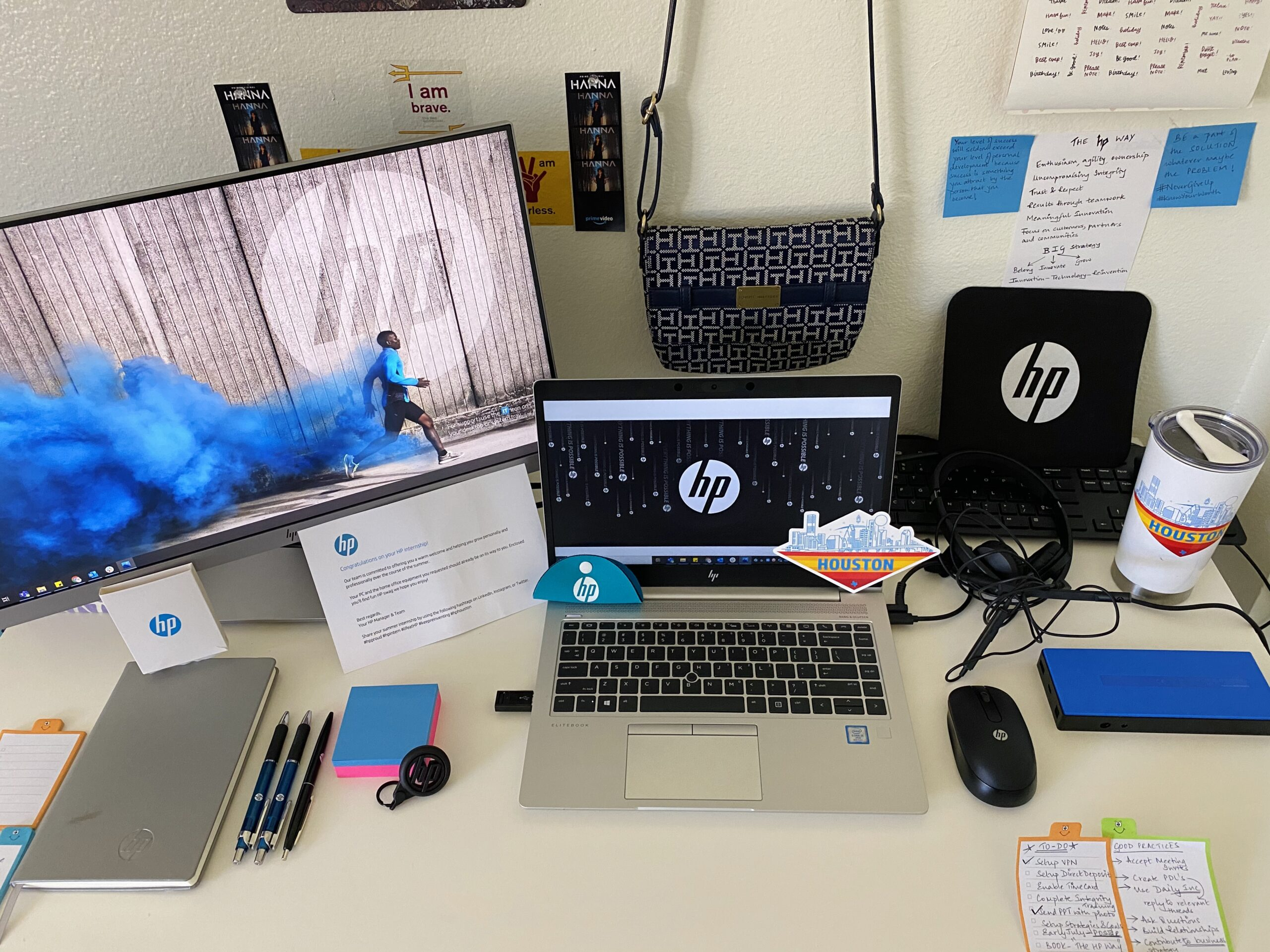 work desk with monitor and laptop computer