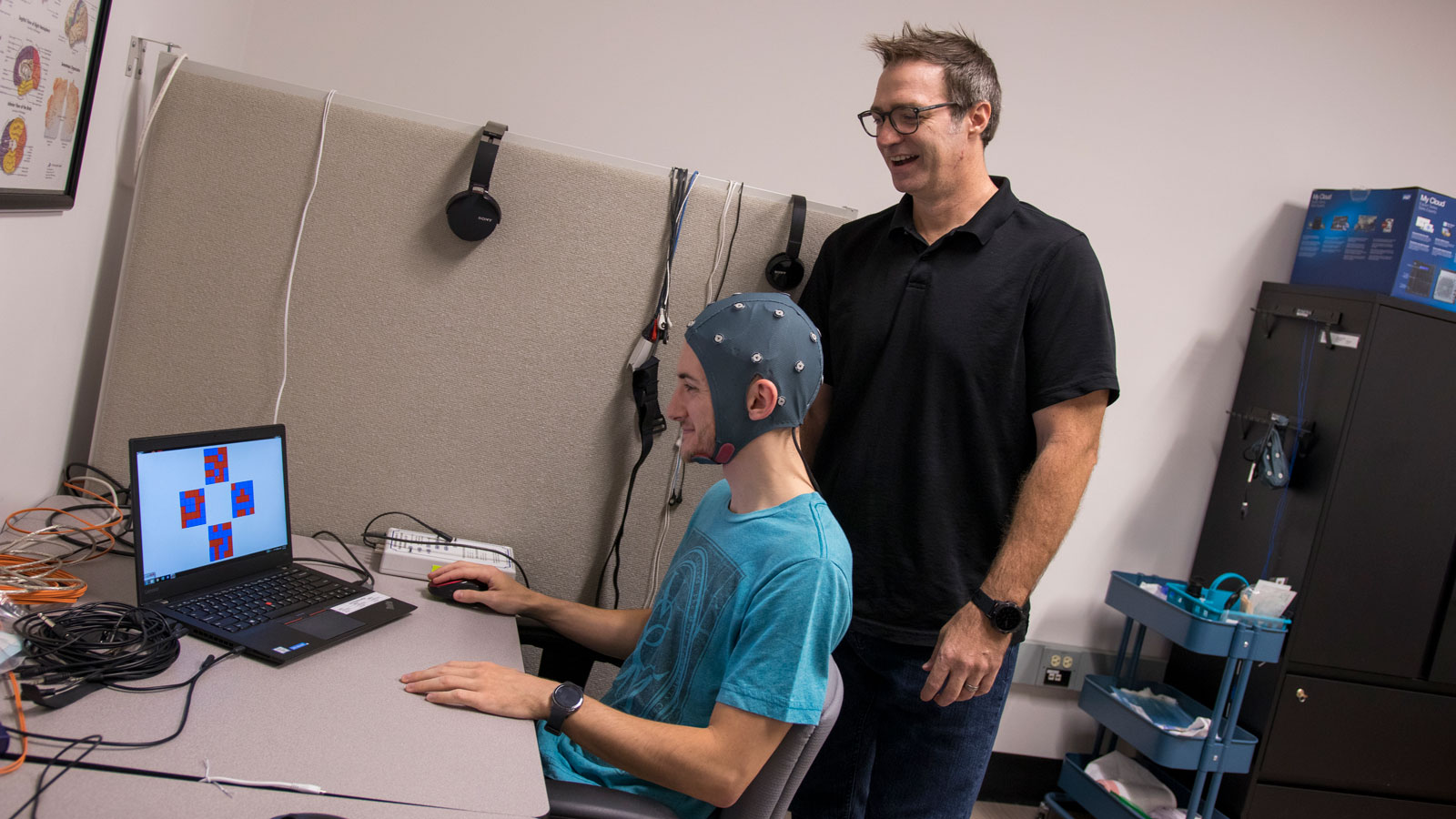 "Associate Professor William ""Jamie"" Tyler works with a student in the Tyler Neurotechnology Lab."