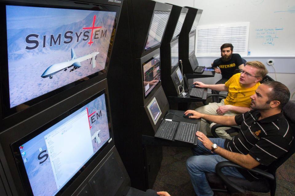 students working at simulators