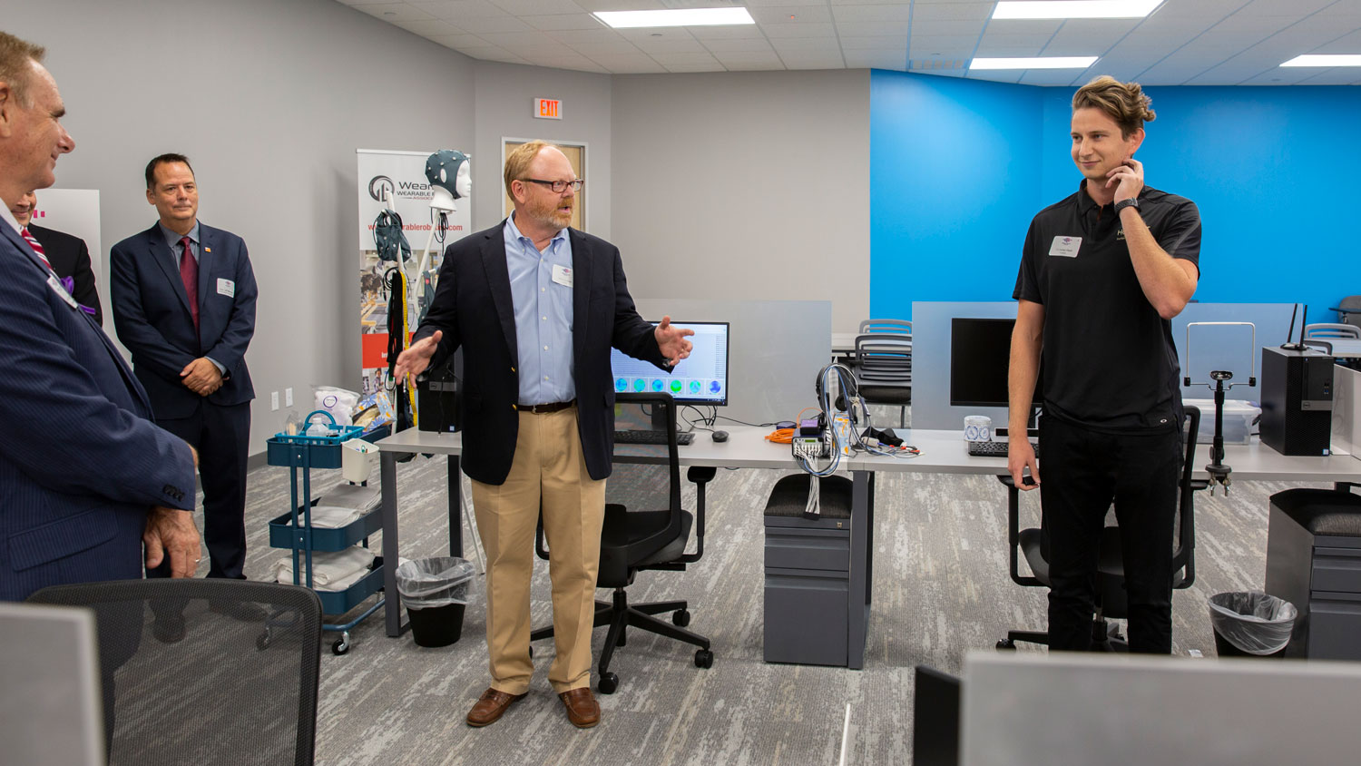 WearTech Applied Research Center Operations Director Wes Gullett (left) introduces Hoolest Performance Technologies to grand opening in September 2019 guests as Nick Hool demonstrates the technology.
